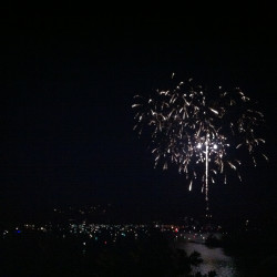 Fireworks over Lake Arrowhead on the Fourth of July. See all the tiny lights dotting the lake? Those are boats gathered around a dock centered in the lake. That's where the fireworks are shot from. This view is via the grand hotel patio. #swerve